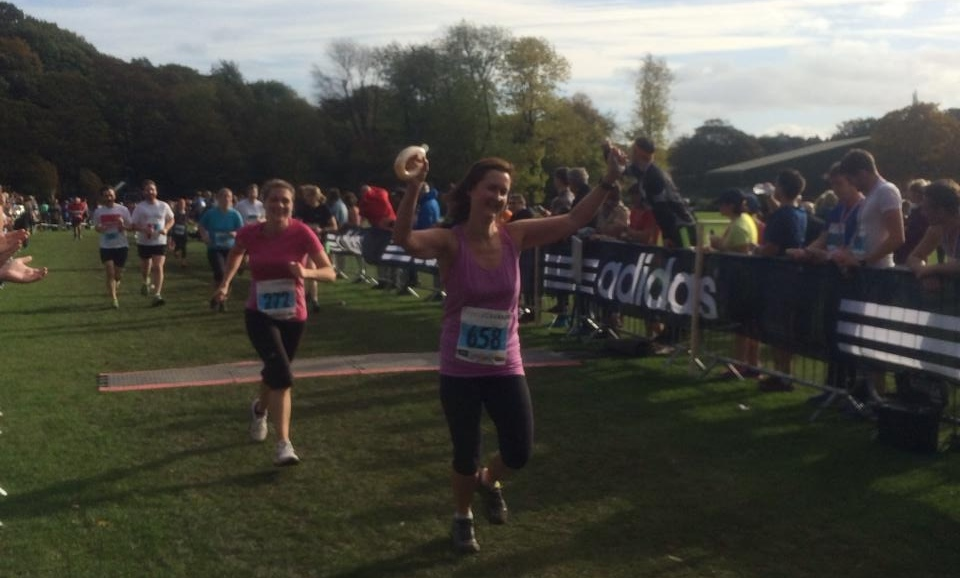Kath crossing the finish line