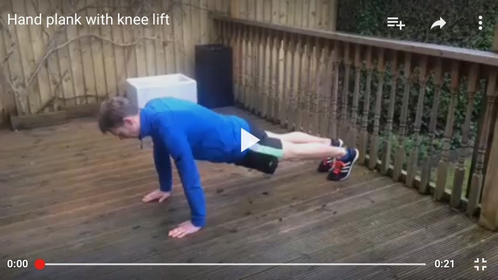 Hand plank with knee raise